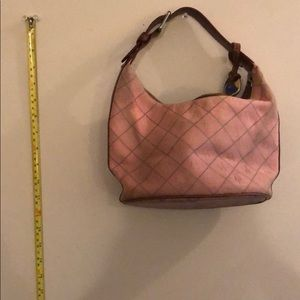 Used and well loved Dooney and Bourke purse